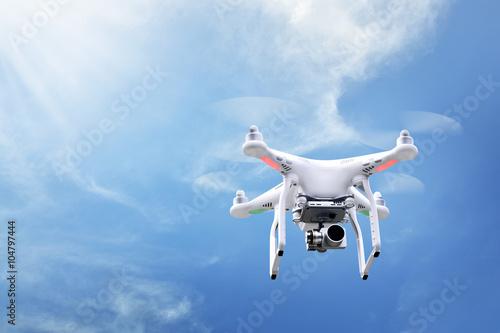 Fototapeta Small white drone hover obraz