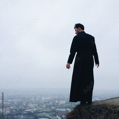 Fototapeta lonely priest on mountains