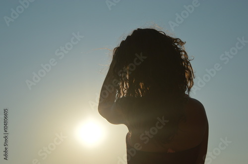 Fototapeta Girl in sunset on beach longing obraz na płótnie