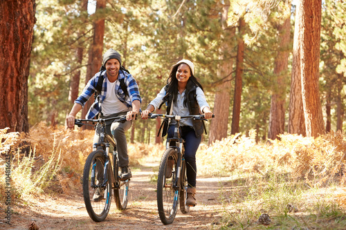 Recess Fitting Cycling African American Couple Cycling Through Fall Woodland
