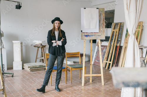 Woman painter working in the studio