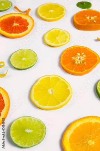 Fotografie, Obraz  Bright colorful design of various citrus fruit slices with oranges, lemons, limes, grapefruit and tangerines
