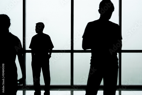 fototapeta na szkło Silhouette of people in front of glass wall background, abstract image