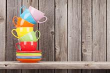 Colorful Coffee Cups On Shelf