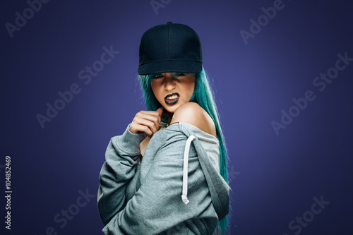 Fotografie, Obraz  Sexy hip hop woman in hoodie and cap