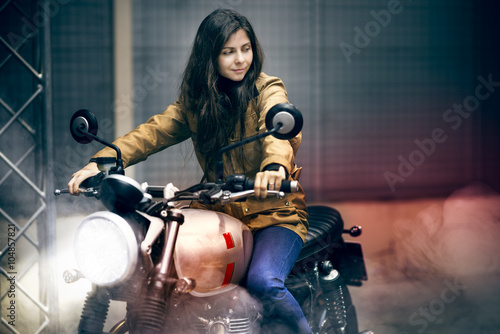 Girl makes a burnout riding an old fashioned motorbike