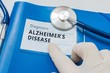 Blue folder with Alzheimer's disease diagnosis