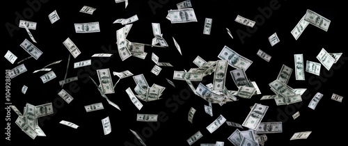 close up of us dollar money flying over black