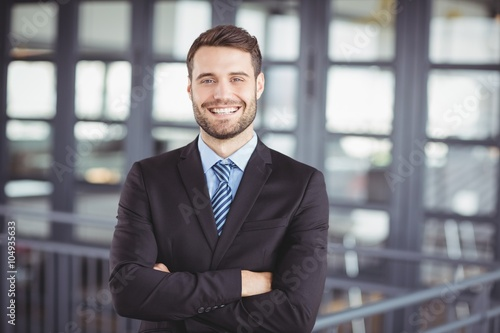 Fotografie, Obraz  Happy businessman with arms crossed
