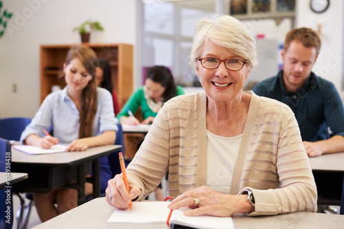 Obraz Happy senior woman at an adult education class looking to camera - fototapety do salonu