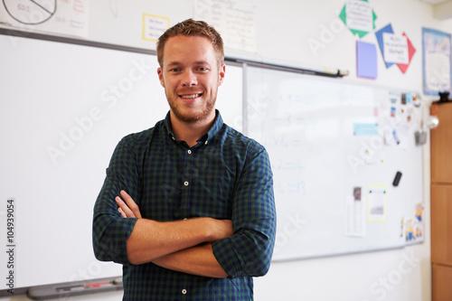 Stampa su Tela Portrait of confident Caucasian male teacher in classroom