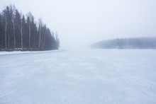 Thick Fog At Frozen Lake Lands...