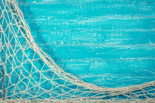 Türaufkleber Schiff Fishing net on old blue board
