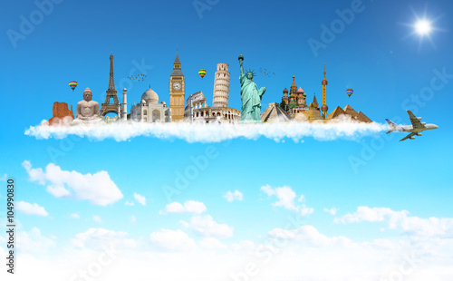 Famous monuments of the world behind a plane in blue sky