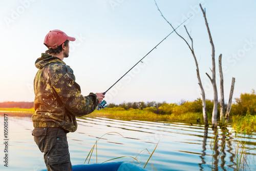 Fotobehang Vissen Man fishing on the lake