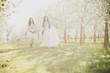 canvas print picture - Maedchen in der Kirschbluete