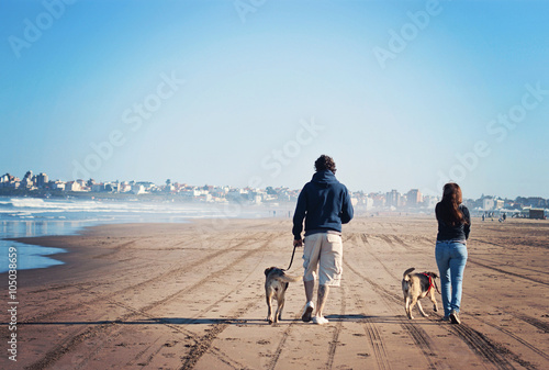 Father and daughter  walking their dogs along the beach in Mar del Plata, Argent Wallpaper Mural