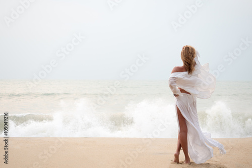 Fototapeta  Woman with sarong on the beach