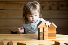 Boy With Wooden Cubes