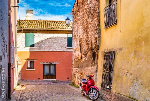 Foto op Canvas Scooter red scooter in narrow street