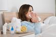 Leinwandbild Motiv Woman Infected With Cold Lying On Bed