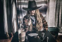 Cowgirl Gunslinger Sitting And...