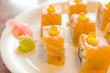 shusi salmon roll on white plate