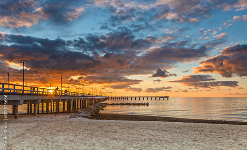 obraz dibond Colorful sunset at a famous marine pier in resort city of Palanga, Lithuania, Europe