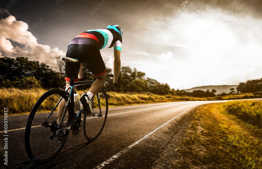 Fototapeta  Men cycling road bike in the morning