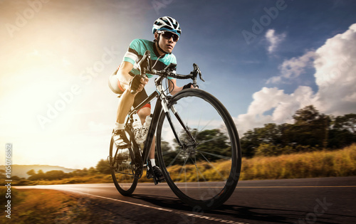 obraz dibond Asian men are cycling road bike in the morning