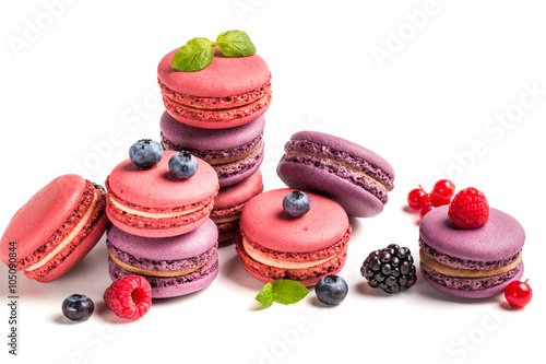 Poster Macarons Delicious macaroons with berry fruits on white background