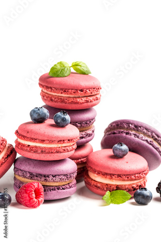 Poster Macarons Delicious macaroons with fruits on white background