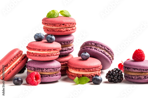 Poster Macarons Fresh macaroons with berry fruits on white background