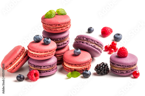 Poster Macarons Fresh macaroons with fruits on white background