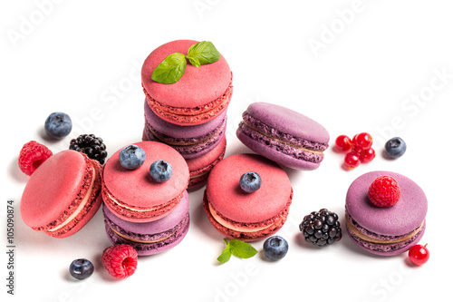 Poster Macarons Colorful macaroons with berry fruits on white background