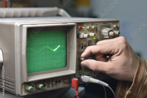 Fotografie, Obraz  Working with oscilloscope in laboratory
