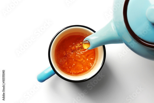 Fotobehang Thee Cup of tea and teapot, isolated on white