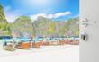opened white door to blurred long tail boat on white sand beach at maya bay, phi phi leh island, thailand