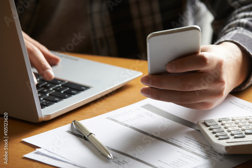 Fotografia, Obraz  Man Doing On Line Banking And Finance At Home