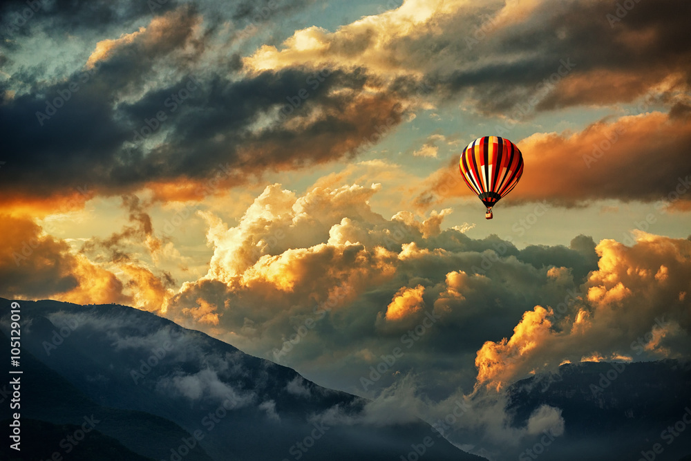Fototapety, obrazy: Hot air balloon in a storm clouds