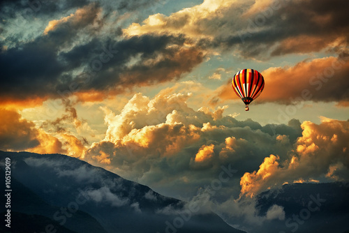 Foto op Plexiglas Zwart Hot air balloon in a storm clouds