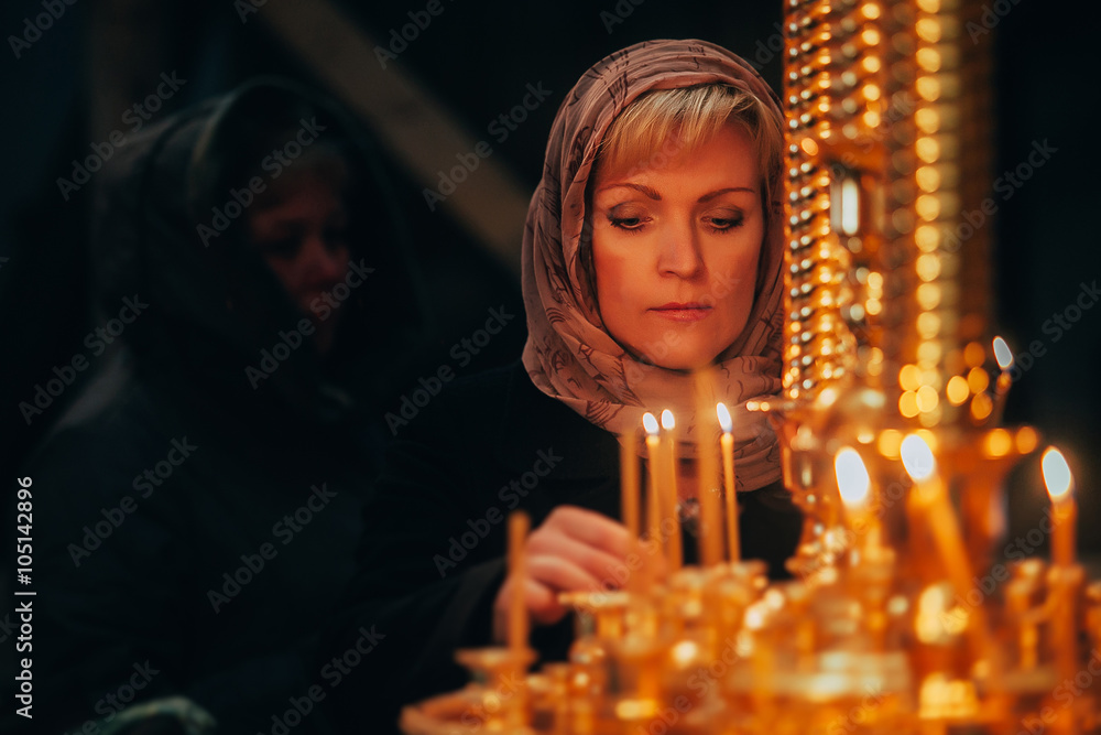 Fototapety, obrazy: Christian russian woman with candle in orthodox russian church