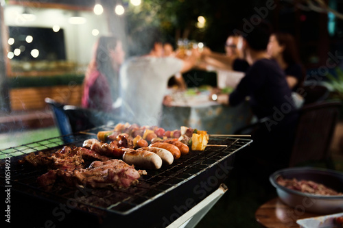 Dinner party, barbecue and roast pork at night Canvas Print