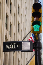 Wall Street Sign With Green Traffic Light Taken In New York City