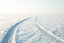 Snow Desert And The Tracks Of The Car In The Snow