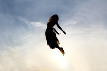 Silhouette Of Woman Rising Int...