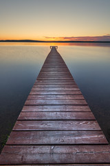 FototapetaOld wooden pier on sunset