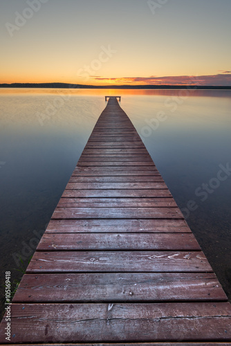 Old wooden pier on sunset - 105169418