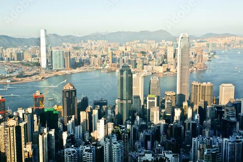 Fotobehang Hong-Kong Cityscape of Hong Kong with waters of Victoria Harbor, a giant asian city
