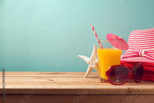 Summer holiday vacation concept with orange juice and beach items